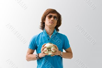 Sporty Asian guy with ball