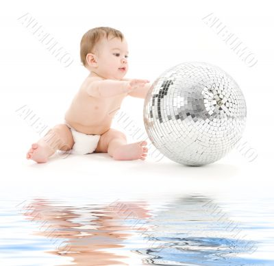 adorable baby boy with big disco ball