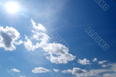 day blue sky with white fluffy clouds