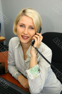 Young businesswoman talk on the phone
