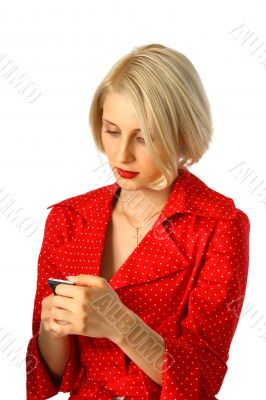 young woman reading message by phone