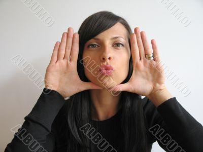 dark hair girl sending a kiss