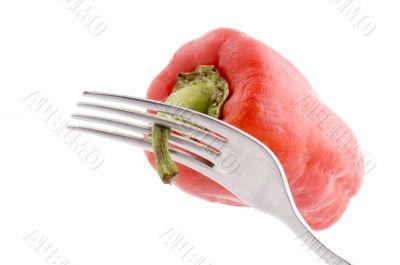 Red pepper on fork