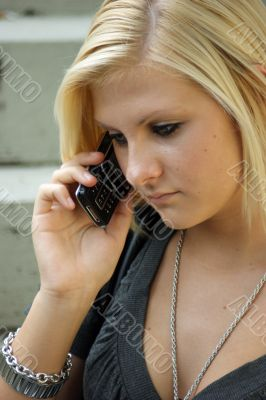 Young, blonde girl with a mobile phone.