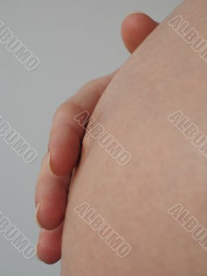 hand on a pregnant belly