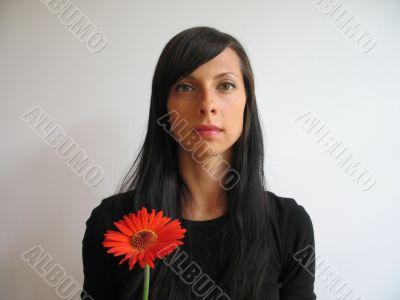 dark hair girl with a flower