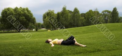 Girl lie on green grass