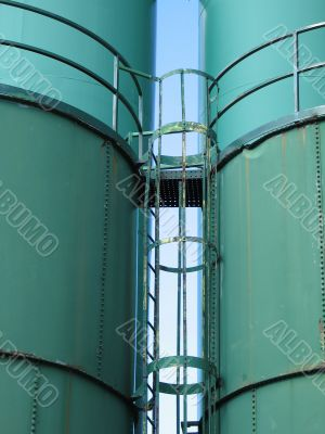 giant green containers, silos