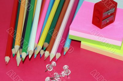 crayons, sticky notes drawing-pins and steel