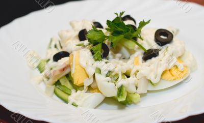Salad of boiled eggs, cucumbers and olives