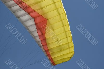 Yellow paraglider wing ear
