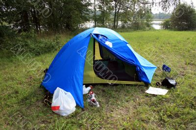 Tent on the lake shore