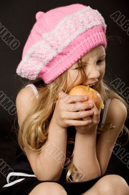 little girl biting apple