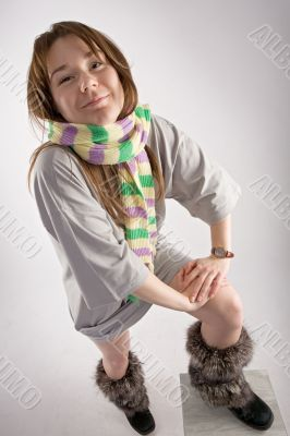 young happy woman in striped muffler