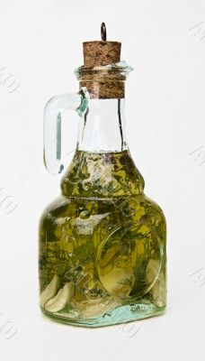 Bottle of olive oil with spice green herbs