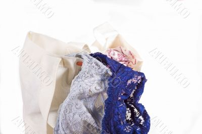 lacy bra falling out of a bag