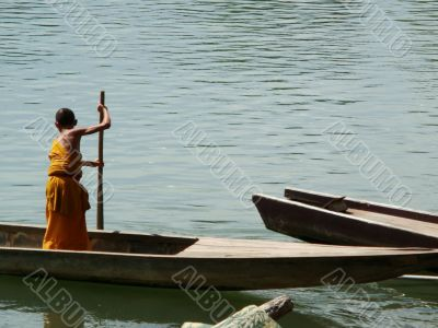 Monk on boat