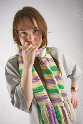 thoughtful young woman in striped muffler
