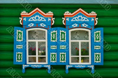 Two open windows of Russian village house