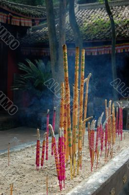 Burning aroma sticks in buddhist church
