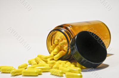 bottle with yellow pills
