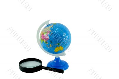 The globe and magnifying glass