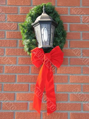 holiday bow around an outdoor light