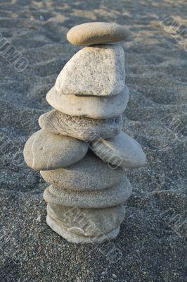 ten stones cairn on the beach