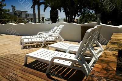 four chaise longue near the swimming pool