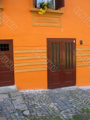 Front door in orange wall.