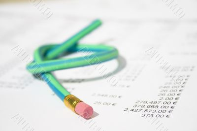 Green rubber pencil twisted into a knot