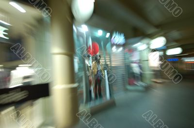 Lonely Mannequin in blurred city