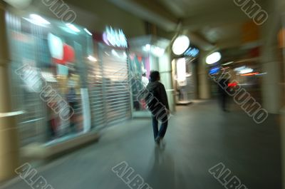 Lonely man  in blurred city
