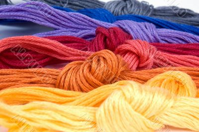 Close-up of several buns of threads