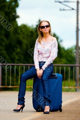 young lady waiting a train