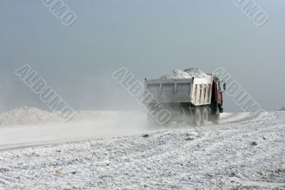 track carries white material of processing