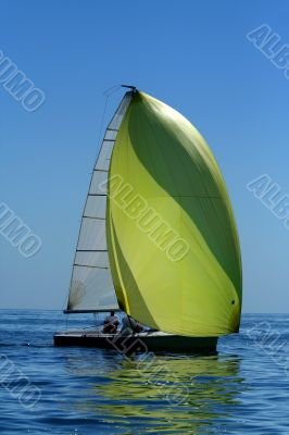 Sailing yaht with spinnaker in the wind