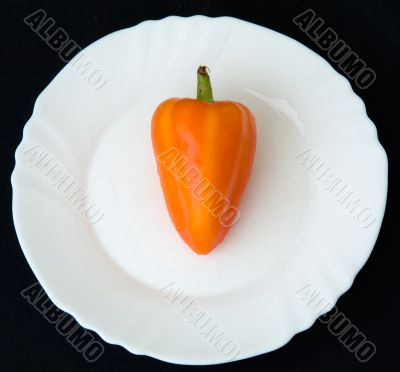 sweet pepper on a white plate