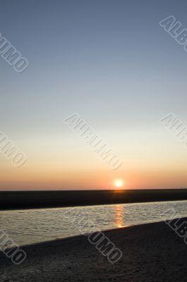 sunrise on the beach on ameland; the netherlands