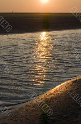 sunrise on the beach on ameland, the netherlands
