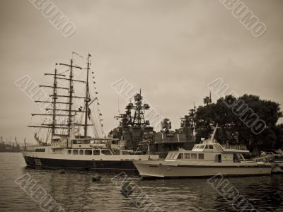 Sailing boat and warship