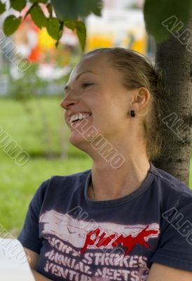 laughing woman under the tree