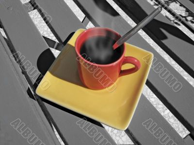 steaming coffee cup on a chair