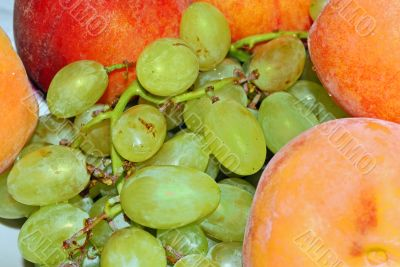 appetizing bunch of grapes and peach
