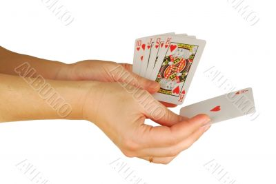 womanish hand holds a playing cards