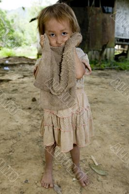 Hmong girl with a dirty cloth, Laos