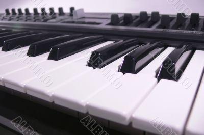 Midi keyboard close up. Piano roll.