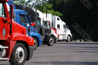 Commercial trucks in a row.