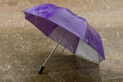 Umbrella at intense rainy weather