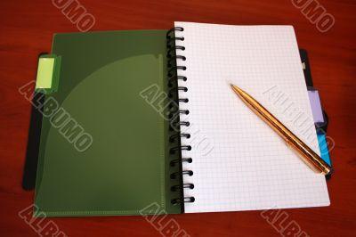 Notebook with golden pen